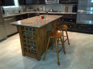 Kitchen w custom island and wine storage